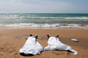 Bodies of migrants who drowned lie on the beach in the Sicilian village of Sampieri