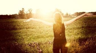 beautiful-girl-in-the-meadow-enjoying-the-sun