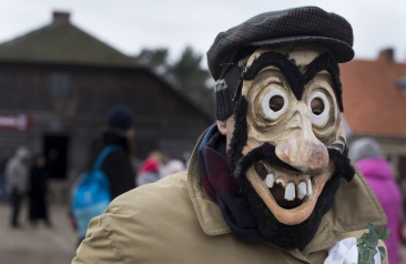 A man wearing a traditional carnival mask dances during Shrovetide celebrations, in the Rumsiskes village, some 89 kilometers (56 miles) north of Vilnius, Lithuania, Saturday, Feb. 6, 2016. Shrovetide is a traditional Lithuanian holiday marking the end of winter, one of the merriest events in Lithuania. (AP Photo/Mindaugas Kulbis)